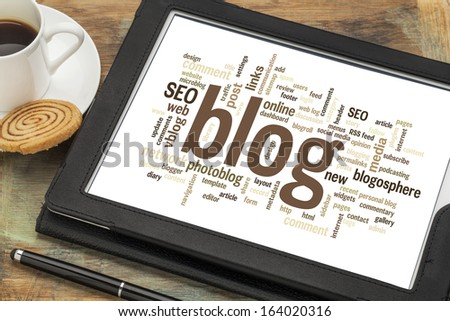 cloud of words or tags related to blogging and blog design on a  digital tablet with cup of coffee - stock photo