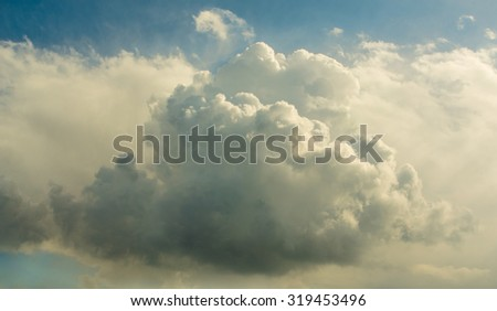Cloud - Organic Cotton. Big conical fluffy cloud in the middle of the sky in a sunny day. - stock photo