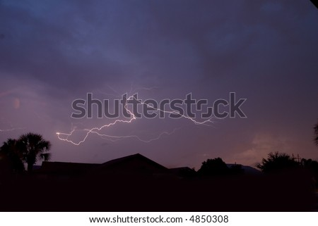 Cloud to cloud spider lightning on a warm summer night - stock photo