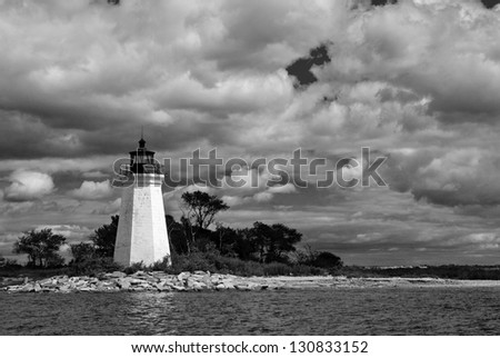 Clouds above Black Rock Harbor lighthouse after a summer rain storm has passed by in Bridgeport, Connecticut. The beacon is also known as Fayerweather Island lighthouse.