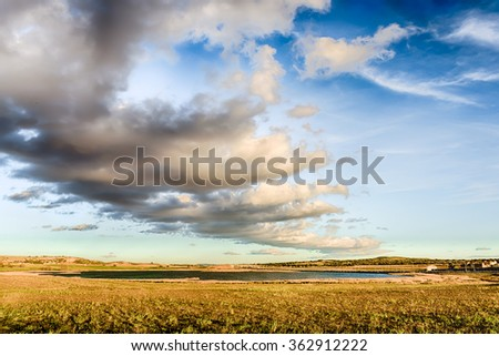 Clouds above the lagoon - stock photo