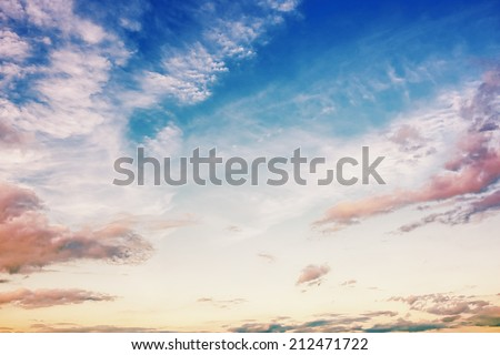 Clouds and blue sky at sunrise / sunset - stock photo