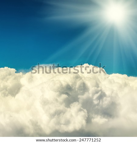 Clouds and blue sky. Natural background with shining sun - stock photo