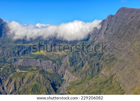 Clouds and cliffs in the Mafate cirque, La Reunion island - stock photo