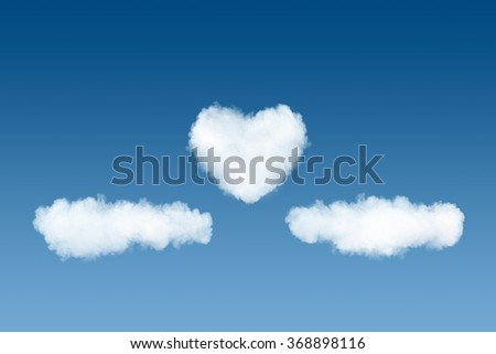 clouds and heart backdrop on blue sky background - stock photo