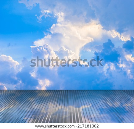 Clouds and sky reflection on glass floor