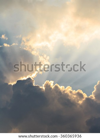 Clouds and sun beams on evening time - stock photo