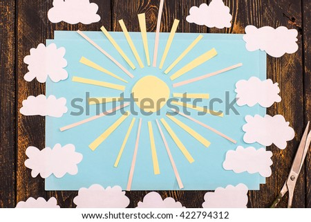Clouds and sun on blue sky. Application of paper.