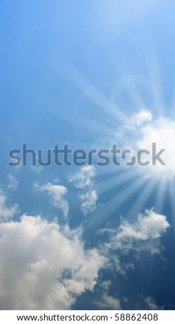 clouds and sunlight rays over blue sky. Perfect for spiritual and religious concepts. - stock photo