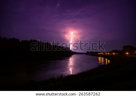 clouds and thunder lightnings and storm in river Tisza. Hungary - stock photo