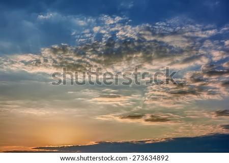 Clouds at sunrise / sunset - stock photo