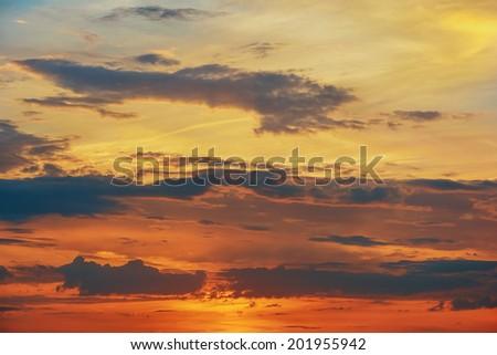 Clouds at sunset / sunrise - stock photo