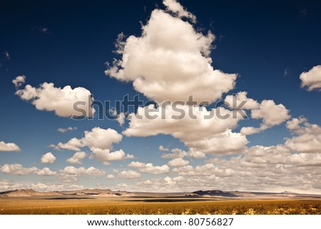 Clouds Drifting Over Wide Open Terrain - stock photo