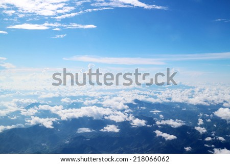 Clouds from above, taken from an airplane. - stock photo