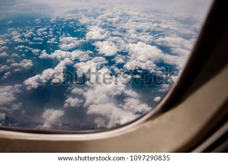 stock-photo-clouds-in-aircraft-window-10