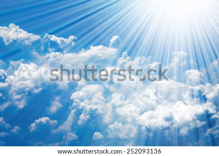 Clouds in blue sky and sun rays - stock photo