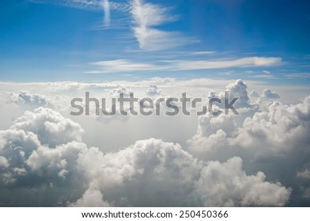 Clouds in blue sky seen from several kilometers above the earth. - stock photo