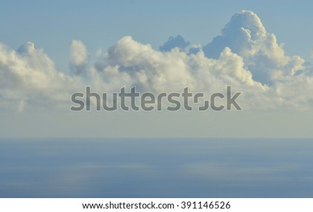 Clouds in the blue sky over the sea - stock photo