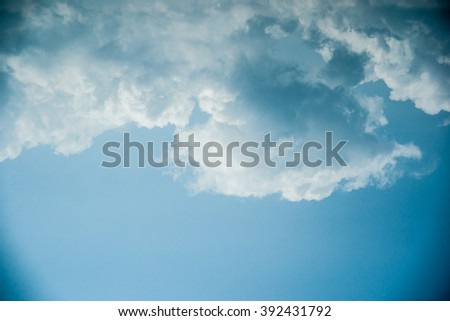 Clouds in the sky. Beautiful vintage photo with a vignette. Can be used as abstract background for different design projects. - stock photo