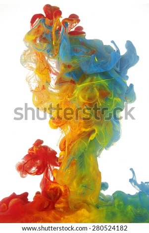 Clouds of bright colorful ink mixing in water - stock photo