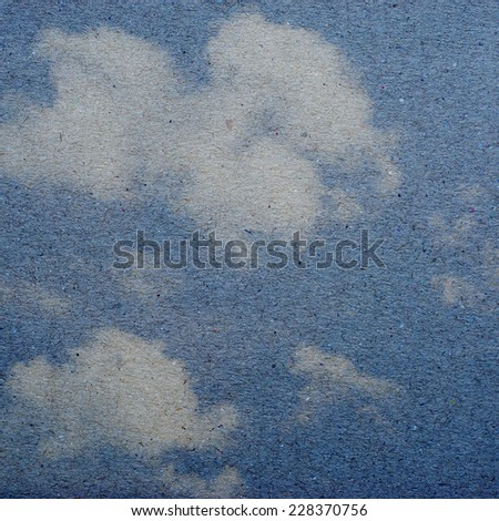 clouds on a textured vintage paper  background,  - stock photo