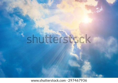 clouds on a textured vintage paper background, with retro stains - stock photo