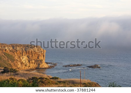Clouds on the rock - stock photo
