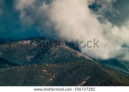 Clouds over a snow capped alpine mountain in the victorian high country, australia. - stock photo