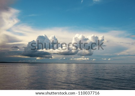 Clouds over Baltic sea. - stock photo