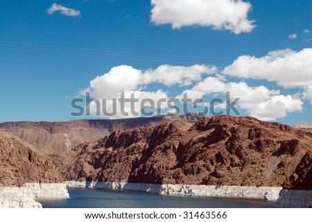 clouds over manmade lake mead for hoover dam in las vegas nevada - stock photo