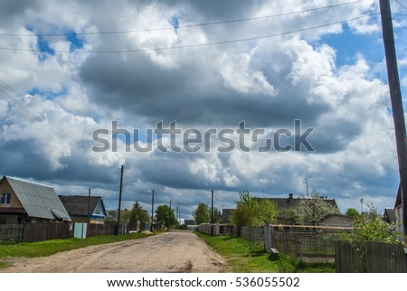 clouds over rural road
