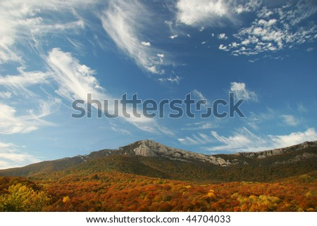 Clouds over the autumn mountain forest