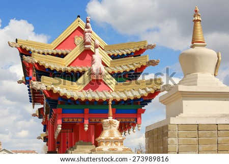 Clouds over the Buddhist temple. Golden Abode of Buddha Shakyamuni in Elista, Republic of Kalmykia, Russia. - stock photo