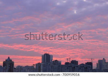 Clouds over the city at sunrise