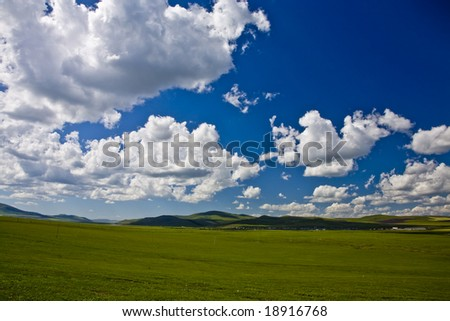 clouds over the meadow in the north of china - stock photo