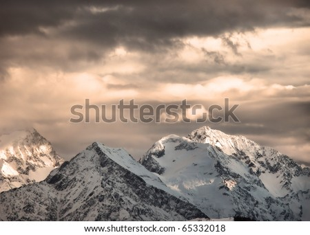 Clouds over the peaks of the French Alps. - stock photo