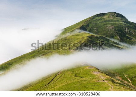 Clouds over the Pyrenees. - stock photo