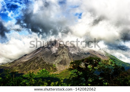 Clouds over the volcanic mountain in Costa Rica - stock photo