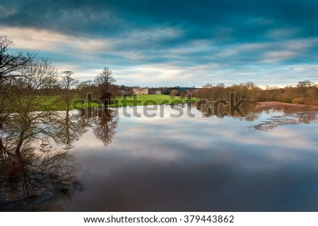 Clouds Reflected in Severn River Waters, Flood Season - stock photo