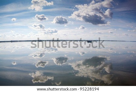 Clouds reflected in water surface. Lebsko Lake at Slowinski National Park. Poland.
