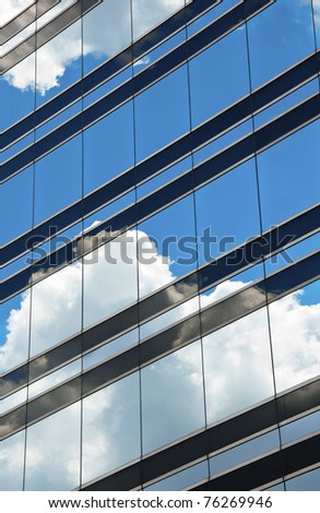 Clouds reflected in windows - stock photo