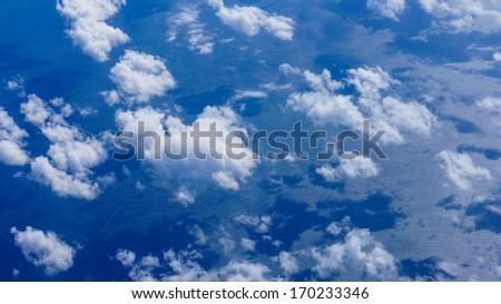 Clouds reflecting on the water, aerial view. - stock photo