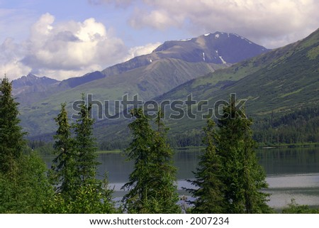 Clouds roll in over remote Alaskan lake - stock photo