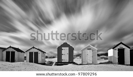 Clouds rushing over the beach huts on Southwold beach