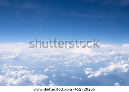 Clouds seen from the airplane during flight / View from the airplane window at daylight