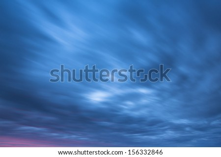Clouds sky in the light of the sunset with blurring effect - stock photo