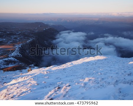 Clouds underfoot. Winter in the mountains