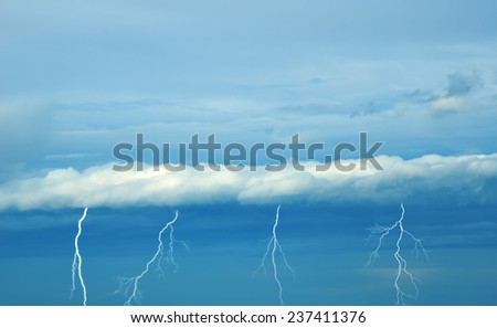 clouds with nice lightnings in summer - stock photo