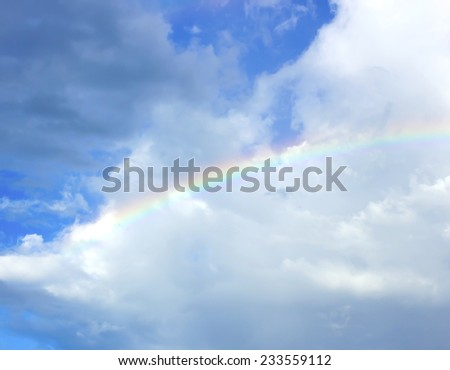clouds with rainbow, sky background - stock photo