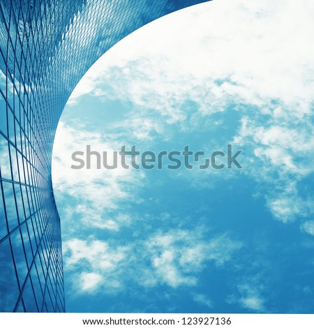 cloudscape and skyscraper wall of glass  ; business abstract background - stock photo
